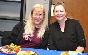 INT staff enjoy a community lunch.